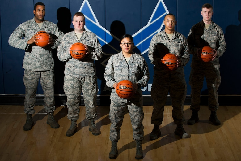 Airmen from the Air Force Technical Applications Center, Patrick AFB, Fla., pose for a photo in the base fitness center.  The Airmen volunteered their off-duty time to serve as youth basketball coaches for a local recreational league.  Pictured from left to right:  Staff Sgt. Jordan Peterson, Staff Sgt. Dustin Elliott, Staff Sgt. Floridamae Mones, Airman 1st Class Willie Robinson and Airman 1st Class Canaan Kennedy.  (U.S. Air Force photo by Phillip C. Sunkel IV)