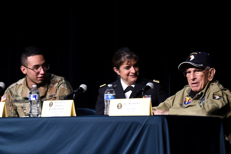 From left to right: U.S. Army National Guard Specialist Henry Torres-Sanchez; U.S. Army Reserve Brig. Gen. Kris. A. Belanger, Commanding General, 85th Support Command, and World War II veteran, Al Mampre, share their military stories during a panel discussion with students during the Elk Grove High School Veterans Day ceremony, Nov. 9, 2018.