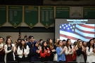 High school students from Elk Grove High School applaud veterans as they arrive during the Elk Grove High School Veterans Day ceremony, Nov. 9, 2018.