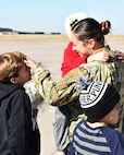 Master Sgt. Jennifer Bilby, 931st Operations Support Squadron Intelligence NCOIC, greets her family after returning from a recent deployment Nov. 15, 2018, McConnell Air Force Base, Kan. More than 35 members of the 931 ARW returned from a deployment to Turkey.