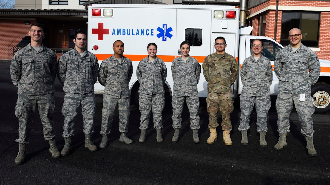 Airmen from the 92nd Medical Operation Squadron medical team pose for a photo at Fairchild Air Force Base, Washington, Nov. 13, 2018. The medical team responded to a respiratory distress call at the commissary on base, providing first aid care and saving a man's life. (U.S. Air Force photo/Airman 1st Class Lawrence Sena)