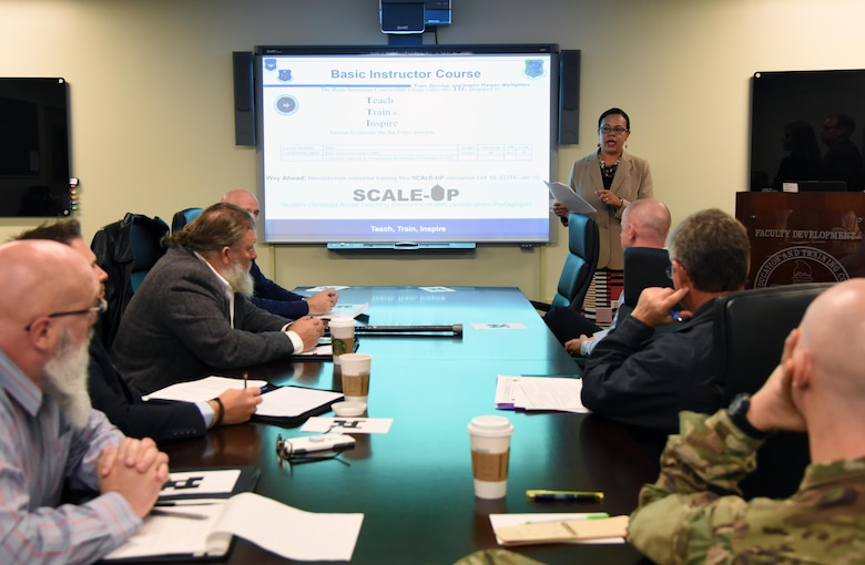 Lisa Rich, 81st Training Support Squadron curriculum developer manager, briefs on student-centered active learning environment with upside-down pedagogies at Keesler Air Force Base, Mississippi, Nov. 13, 2018. Personnel from Goodfellow AFB, Texas, and Vandenberg AFB, California, visited squadrons within the 81st Training Group to review methodologies currently being used in the 81st TRG course curriculum. (U.S. Air Force photo by Kemberly Groue)