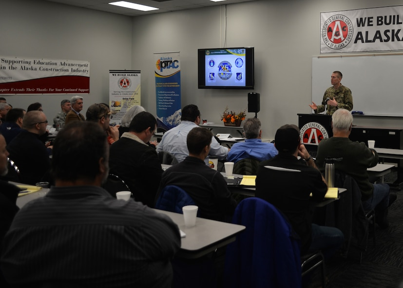 Maj. Cal Gentry, 354th Contracting Squadron commander, briefs Alaskan business leaders at an Interior Alaska Industry Day event in Fairbanks, Alaska, Nov. 14, 2018. The event gathered more than 150 business leaders in order to answer questions, as well as inform and educate on the contracting process with the Federal Government. (U.S. Air Force photo by Capt. Kay M. Nissen)