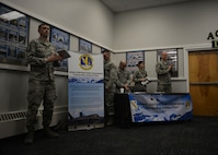 354th Fighter Wing Airmen standby an information booth at an Interior Alaska Industry Day event in Fairbanks, Alaska, Nov. 14, 2018. The 354th Contracting Squadron brought several contracting officers, as well as legal and finance officers to the event in order to promote open and transparent information sharing. (U.S. Air Force photo by Capt. Kay M. Nissen)