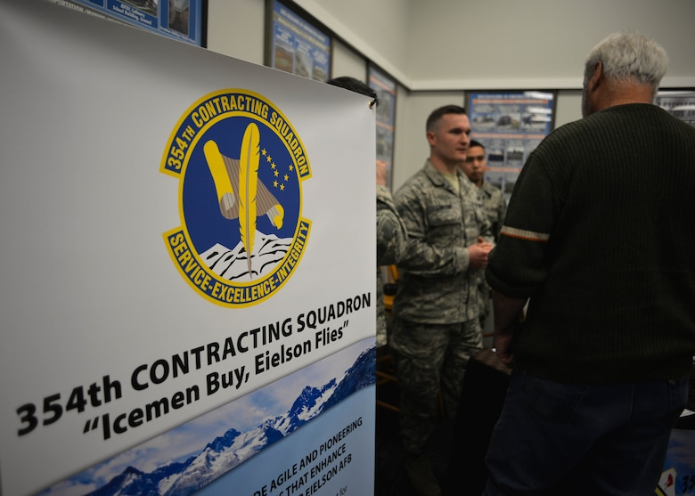 354th Fighter Wing Airmen speak with Alaskan business owners during an Interior Alaska Industry Day held in Fairbanks, Alaska, Nov. 14, 2018. This past year, the 354th Contracting Squadron has awarded nearly 80% of all contract dollars to Alaskan businesses. (U.S. Air Force photo by Capt. Kay M. Nissen)