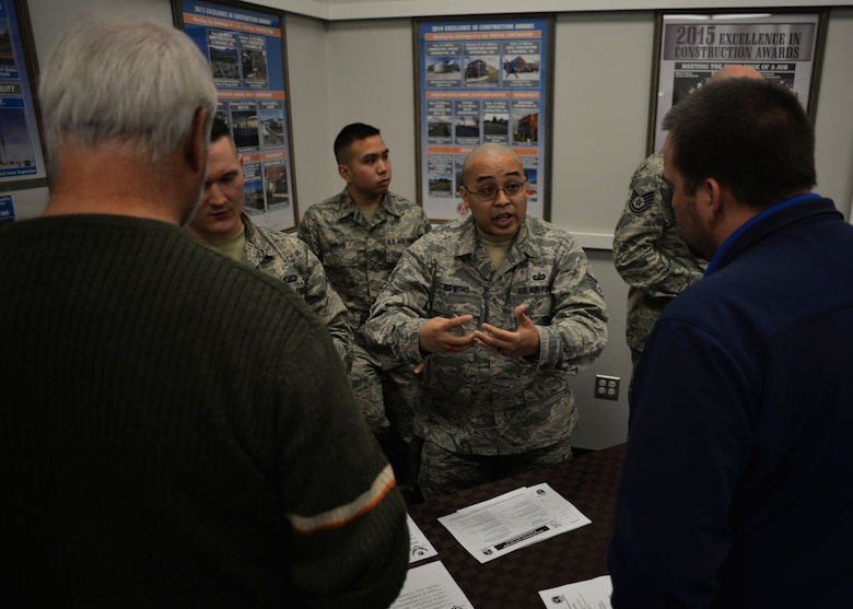 Tech. Sgt. Zachary Bowens, a 354th Contracting Squadron member, talks with Alaskan business leaders at an Interior Alaska Industry Day event in Fairbanks, Alaska, Nov. 14, 2018. The purpose of the industry day was to inform and educate local businesses on the contracting process with the Federal Government. (U.S. Air Force photo by Capt. Kay M. Nissen)