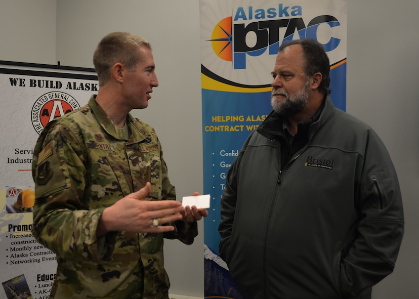 Maj. Cal Gentry, 354th Contracting Squadron commander, talks with an Alaskan business owner at an Interior Alaska Industry Day event in Fairbanks, Alaska, Nov. 14, 2018. During the industry event, Air Force and Army contracting officers forecasted 60 construction projects for interior Alaska during fiscal year 2019. (U.S. Air Force photo by Capt. Kay M. Nissen)