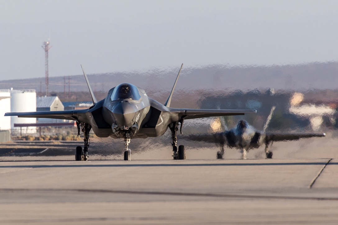 Two F-35s taxi down a taxi-way at Edwards Air Force Base, Aug. 16, 2017. The 461st Flight Test Squadron have recently begun flight testing the Automatic Ground Collision Avoidance System (Auto GCAS) onboard the F-35 aircraft. (U.S. Air Force photo by Darin Russel)