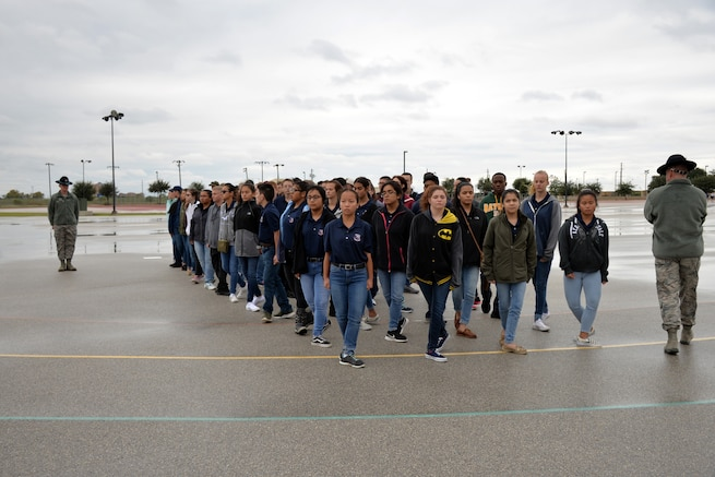 Senior Master Sgt. Jason B. Wagner and Master Sgt. Robert E. Elliott, 433rd Training Squadron military training instructors, instruct Rowlett High School Air Force Junior Reserve Officer's Training Corps cadets on drill movements at Joint Base San Antonio-Lackland, Texas Nov. 9, 2018.