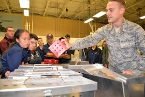 Tech Sgt. Nathaniel D. Ball, 433rd Maintenance Squadron sheet metal mechanic, explains how the Reserve Citizen Airmen in the metals and structural shops create replacement parts for the C-5M Super Galaxy to Rowlett High School Air Force Junior Reserve Officer's Training Corps cadets at Joint Base San Antonio-Lackland, Texas Nov. 9, 2018.