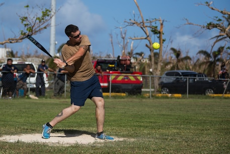 Petty Officer 3rd Class Maxwell Manville, a construction mechanic with Naval Mobile Construction Battalion 1, hits a ball at a community relations baseball event during U.S. Defense Support of Civil Authorities relief efforts on Tinian, Commonwealth of the Northern Mariana Islands, Nov. 9, 2018. Manville, a native of Reno, Nevada, graduated from Reed High School in June 2014 before enlisting in June 2015. Businesses, government buildings, homes and schools were heavily damaged by Super Typhoon Yutu, which made a direct hit with devastating effect on Tinian Oct. 25 as the second strongest-storm to ever hit U.S. soil. Marines with the 31st Marine Expeditionary Unit and Combat Logistics Battalion 31 arrived on Tinian Oct. 29-31 in the wake of Super Typhoon Yutu as part of Task Force-West. TF-W is providing Department of U.S. Defense support to the CNMI's civil and local officials as part of the FEMA-supported Super Typhoon recovery effort. The 31st MEU, the Marine Corps' only continuously forward-deployed MEU, provides a flexible force ready to perform a wide-range of military operations across the Indo-Pacific region. (U.S. Marine Corps photo by Lance Cpl. Hannah Hall/Released)