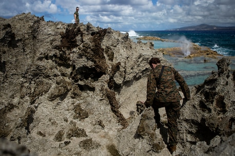 Marines with the 31st Marine Expeditionary Unit visit the ocean side 'Blowhole' on Tinian, Commonwealth of the Northern Mariana Islands, Nov. 11, 2018. Marines with the 31st MEU and Combat Logistics Battalion 31 have been leading the multi-service Department of Defense's Defense Support of Civil Authorities relief efforts here since Oct. 29 in the wake of Super Typhoon Yutu, which wreaked havoc as the second strongest storm to ever hit U.S. soil on Oct. 25. Tinian, host of a 1944 WWII battle during the Marianas Campaign, is part of the U.S. Commonwealth of the Northern Mariana Islands. More than 320 Marines, sailors and soldiers died during the battle here in June and July 1944 as allied forces moved toward Imperial Japan. As a historic battle site, Marines and sailors with both the 31st MEU and CLB-31 spent time exploring the island during the DSCA mission to learn about its significance in American history. (U.S. Marine Corps photo by Gunnery Sgt. T. T. Parish/Released)