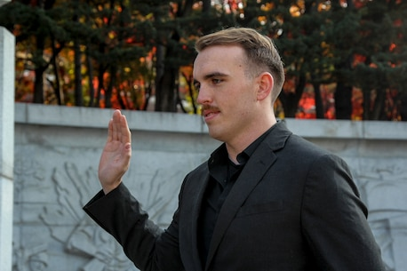 "INCHEON, Republic of Korea – Cpl. Ryan Kincannon, G-6 cyber network administrator, recites the oath of enlistment during his reenlistment ceremony here, Nov. 14. Kincannon made his pledge to serve another 4 years in the Marine Corps standing atop a hill once occupied as the command post for Lewis B. ""Chesty"" Puller during the Battle for Inchon. (Official Marine Corps photo by Sgt. Nathaniel Hanscom/Released)"