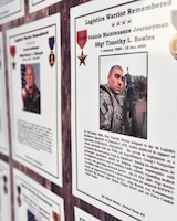 The 380th Expeditionary Logistics Readiness Squadron put together a bulletin board to remember the fallen ELRS Airmen that died downrange since Operation ENDURING FREEDOM and IRAQI FREEDOM at Al Dhafra Air Base, United Arab Emirates, Nov. 8, 2018. The fallen Airmen all ranged from Airman 1st Class to Captain, all under the age of 28 years old and were mostly killed by improvised explosive device attacks. (U.S. Air Force photo by Senior Airman Mya M. Crosby)
