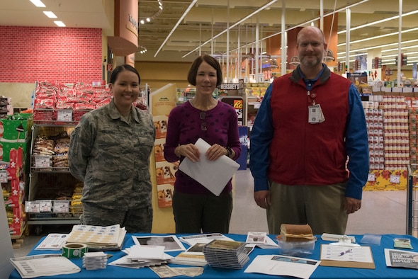 From left, U.S. Air Force Senior Airman Rebecca Valadez 86th Airlift Wing Dental Squadron dental assistant, Charlie Engeman, Health Promotion volunteer, and Brian Kirby, 86th Medical Group Health Promotion coordinator, pose for a photo during the Great American Smokeout event on Ramstein Air Base, Germany, Nov 15, 2018. The event presented an opportunity for smokers to dispose of their tobacco for a free turkey sandwich and pledge to quit smoking. (U.S. Air Force photo by Airman 1st Class Kaylea Berry)