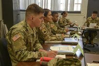 Soldiers discuss experiences and take notes during class at the Louisiana National Guard's 199th Regiment (Regional Training Institute) Basic Leadership Course at Camp Cook in Ball, Louisiana. The LANG's BLC started a new curriculum during the August rotation that will be in effect at all schoolhouses Army wide by January 2020.