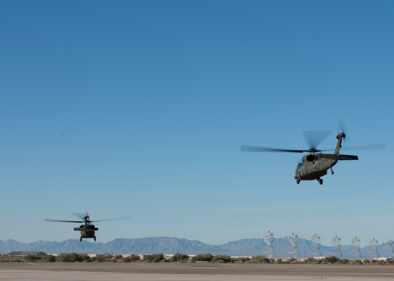 Two UH-60 Black Hawk helicopters take off of Holloman Air Force Base, N.M., November 14, 2018. Gen. Paul Selva, vice chairman of the Joint Chiefs of Staff, visited Holloman November 13 to 14, and received a helicopter tour of White Sands Missile Range, N.M. (U.S. Air Force photo by Staff Sgt. BreeAnn Sachs).