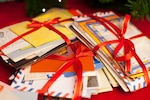 Christmas letters tied with red ribbon.