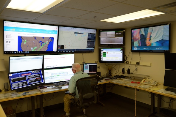 Meteorologist Philip Studler working at the weather station at Base Operations. (U.S. Air Force photo/Loren Deer)