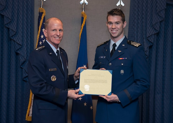 Cadet 2nd Class Kyle Haak receives the 2018 U.S. Air Force Cadet of the Year award from Air Force Vice Chief of Staff Gen. Stephen V. Wilson during a ceremony at the Pentagon, Arlington, Va., Nov. 6, 2018. Established in 2000 by the private British Air Squadron organization, the award is a symbol of the enduring British-American friendship. (U.S. Air Force photo by Staff Sgt. Victoria H. Taylor)