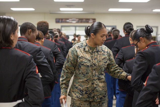 Sgt. Cristal Abregomedina, a warehouse clerk with Headquarters and Service Battalion, examines the uniforms of Marines from November Company, 4th Recruit Training Battalion Nov. 9, 2018 at Marine Corps Recruit Depot Parris Island, S.C. (Official Marine Corps Photo by Staff Sgt. Tyler Hlavac)