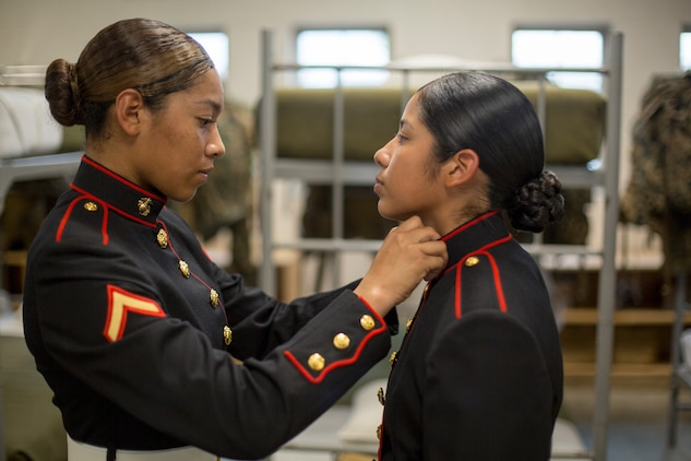 Pfc. Kathy Espinoza, from New York City, N.Y. inspects the uniform of Pvt. Arella Aleman, from Dallas, Texas Nov. 9, 2018 at Marine Corps Recruit Depot Parris Island, S.C. (Official Marine Corps Photo by Staff Sgt. Tyler Hlavac)