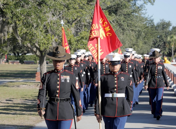 Drill Instructors and Marines with November Company, 4th Recruit Training Battalion march towards the Peatross Parade Deck before their graduation ceremony Nov. 16, 2018 at Marine Corps Recruit Depot Parris Island, S.C. (Official U.S. Marine Corps Photo by Lance Cpl. Yamil Casarreal)