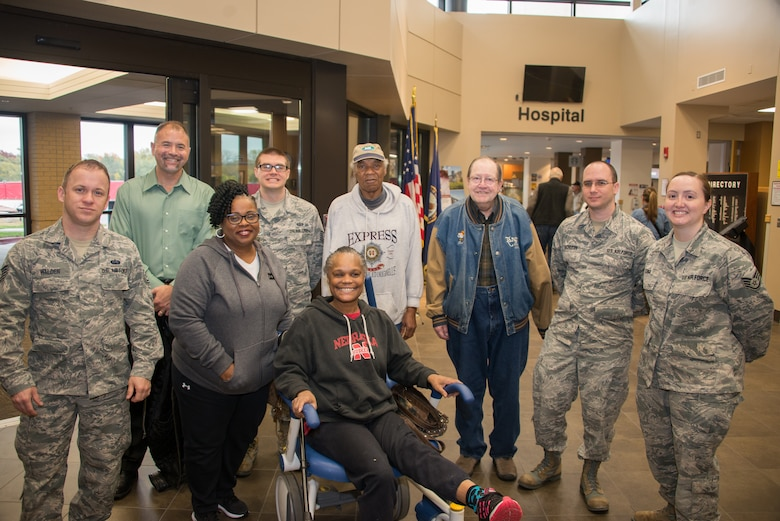 Airmen from the 2nd Weather Support Squadron pose for a group photo with patients at the Omaha VA Medical Center in Omaha, Nebraska, Oct. 26, 2018. The squadron chose to visit with veterans as part of Offutt Air Force Base's Wingman Day, which is designed to build resiliency through teambuilding activities. (U.S. Air Force photo by Paul Shirk)