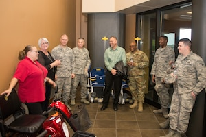Airmen from the 2nd Weather Support Squadron (WSS) speak with staff from the Omaha Veterans Administration Medical Center in Omaha, Nebraska, Oct. 26, 2018. The Airmen visited with veterans in both the in-patient and out-patient areas of the hospital, whose military careers went back as far as World War II. (U.S. Air Force photo by Paul Shirk)