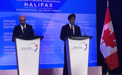 Peter Van Praagh, president of the Halifax Forum, and Canadian Defense Minister Harjit Sajjan discuss security challenges that will be aired at the Halifax International Security Forum during a press conference in Halifax, Nova Scotia.