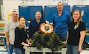 The 76th Propulsion Maintenance Group Rubber Team with their winning pumpkin, Ghillie's Eye. From left, Danny Fisher, Misha Hennigh, Deedee Yeary, Mark Willcutt and Erica Ross.