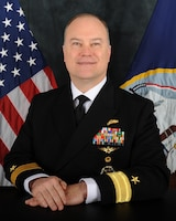 Navy Rear Adm. William Chase poses for an official photo.