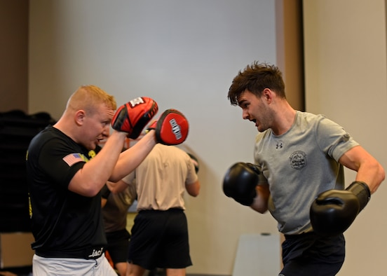 U.S Air Force Senior Airman Skyler Pendleton, 22nd Training Squadron Survival, Evasion, Resistance and Escape specialist and SERE Combatives Program instructor, blocks punches from Airman 1st Class Justin Croteau, 22nd TRS SERE specialist, during a four-hour block of combative training at Fairchild Air Force Base, Washington, Nov. 7, 2018. The 80-hour program trains on projectile, striking, clenching and grappling self-defense techniques. (U.S. Air Force photo/Airman 1st class Jesenia Landaverde)