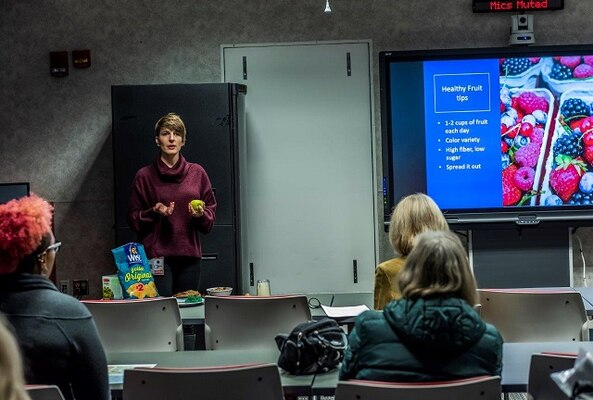Julie Palmer teaches associates on nutrition tips during World Diabetes Day presentation