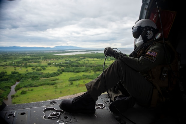 Naval Aircrewman (Helicopter) 2nd Class Nicholas Glass, from Salisbury, N.C., looks out across the Colombian landscape from aboard an MH-60S Seahawk.