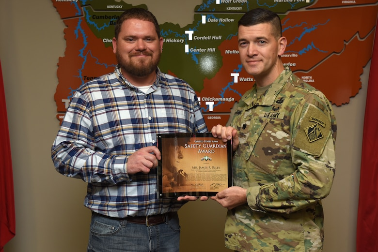 Lt. Col. Cullen Jones, U.S. Army Corps of Engineers Nashville District commander, presents the United States Army Safety Guardian Award to James Riley, Wolf Creek Dam Power Plant operator trainee, during a ceremony Nov. 15, 2018 at the Nashville District Headquarters in Nashville, Tenn. Riley is one of five employees whose quick actions to evacuate an injured contractor from a confined space July 9, 2018 at Wolf Creek Dam in Jamestown, Ky., reduced the time it took for the victim to receive life-saving medical treatment. (USACE photo by Lee Roberts)