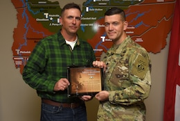 Lt. Col. Cullen Jones, U.S. Army Corps of Engineers Nashville District commander, presents the United States Army Safety Guardian Award to Eric Todd McGowan, Power Plant maintenance worker, during a ceremony Nov. 15, 2018 at the Nashville District Headquarters in Nashville, Tenn. McGowan is one of five employees whose quick actions to evacuate an injured contractor from a confined space July 9, 2018 at Wolf Creek Dam in Jamestown, Ky., reduced the time it took for the victim to receive life-saving medical treatment. (USACE photo by Lee Roberts)