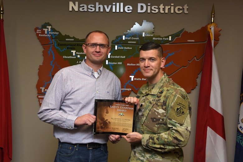 Lt. Col. Cullen Jones, U.S. Army Corps of Engineers Nashville District commander, presents the United States Army Safety Guardian Award to Anthony Watters, Wolf Creek Dam Power Plant superintendent, during a ceremony Nov. 15, 2018 at the Nashville District Headquarters in Nashville, Tenn. Watters is one of five employees whose quick actions to evacuate an injured contractor from a confined space July 9, 2018 at Wolf Creek Dam in Jamestown, Ky., reduced the time it took for the victim to receive life-saving medical treatment. (USACE photo by Lee Roberts)