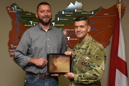 Lt. Col. Cullen Jones, U.S. Army Corps of Engineers Nashville District commander, presents the United States Army Safety Guardian Award to Christopher Marlow, Wolf Creek Dam Power Project manager, during a ceremony Nov. 15, 2018 at the Nashville District Headquarters in Nashville, Tenn. Marlow is one of five employees whose quick actions to evacuate an injured contractor from a confined space July 9, 2018 at Wolf Creek Dam in Jamestown, Ky., reduced the time it took for the victim to receive life-saving medical treatment. (USACE photo by Leon Roberts)