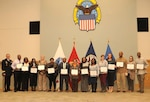Employees receive recognition awards