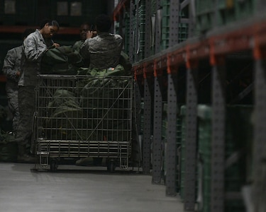 628th Logistics Readiness Squadron Airmen prepare mobility bags during a readiness exercise Nov. 12, 2018 at Joint Base Charleston, S.C. To keep the training as realistic as possible, participants from across JB Charleston received the equipment, weapons and specialty uniform items they would use in real-world situations. The simulated scenarios enabled senior base leaders and subject matter experts to ensure the readiness of JB Charleston's quick response capabilities.