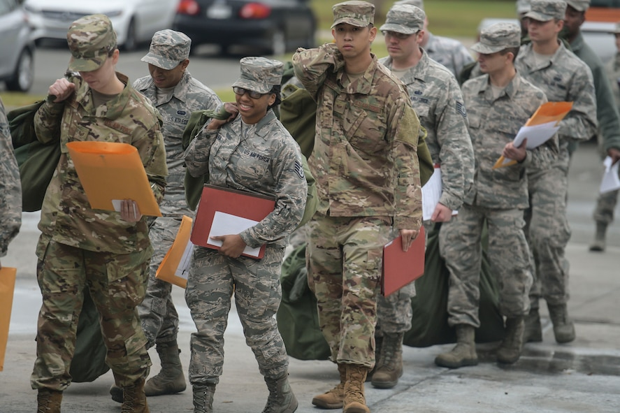 A group of Airmen prepare for a mock deployment during an operational readiness exercise Nov. 12, 2018, at Joint Base Charleston, S.C. To keep the training as realistic as possible, participants from across JB Charleston received the equipment, weapons and specialty uniform items they would use in real-world situations. The simulated scenarios enabled senior base leaders and subject matter experts to ensure the readiness of JB Charleston's quick response capabilities.