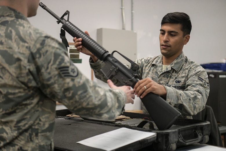 Airman 1st Class Andrew Brewer, 628th Logistics Readiness Squadron apprentice, issues an M-16 during an operational readiness exercise Nov 14, 2018, Joint Base Charleston, S.C. To keep the training as realistic as possible, participants from across JB Charleston received the equipment, weapons and specialty uniform items they would use in real-world situations. The simulated scenarios enabled senior base leaders and subject matter experts to ensure the readiness of JB Charleston's quick response capabilities.