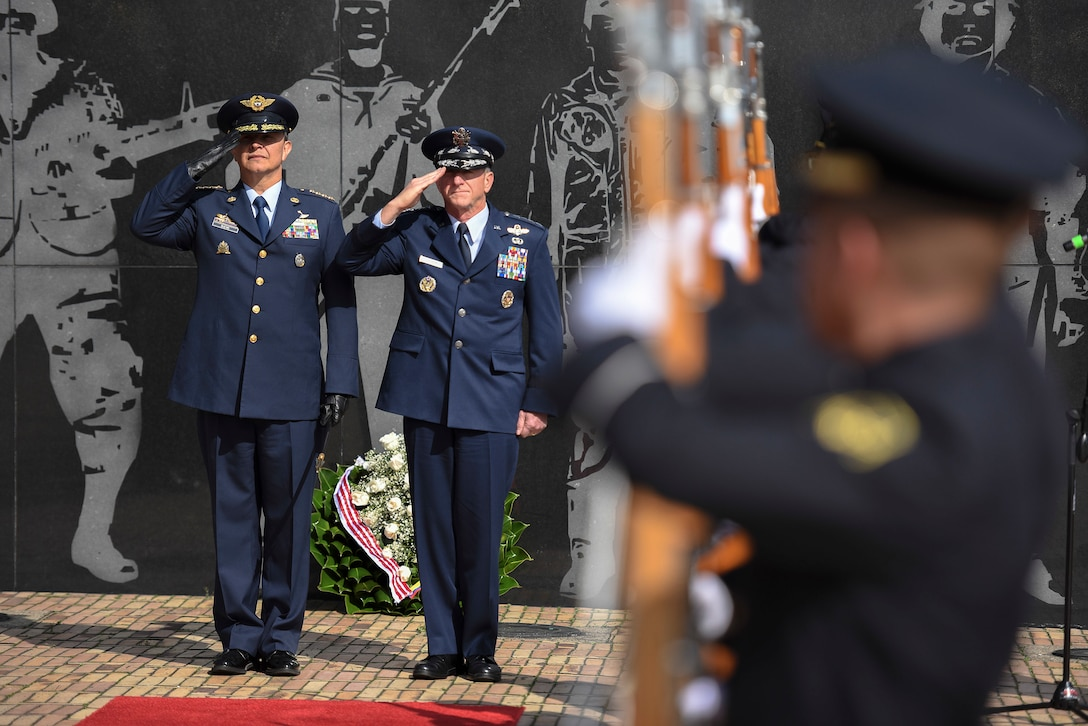 Air Force Chief of Staff Gen. David L. Goldfein and Commander of the Colombian Air Force General Carlos Eduardo Bueno Vargas render salutes during a ceremony at the Memorial Heroes Caidos en Combate in Bogota, Colombia, Nov. 15, 2018. During the ceremony, which took place during his visit to the country Nov. 14-15, Goldfein laid a wreath to honor Colombian troops lost in battle. (U.S. Air Force photo by Tech Sgt. Anthony Nelson Jr.)