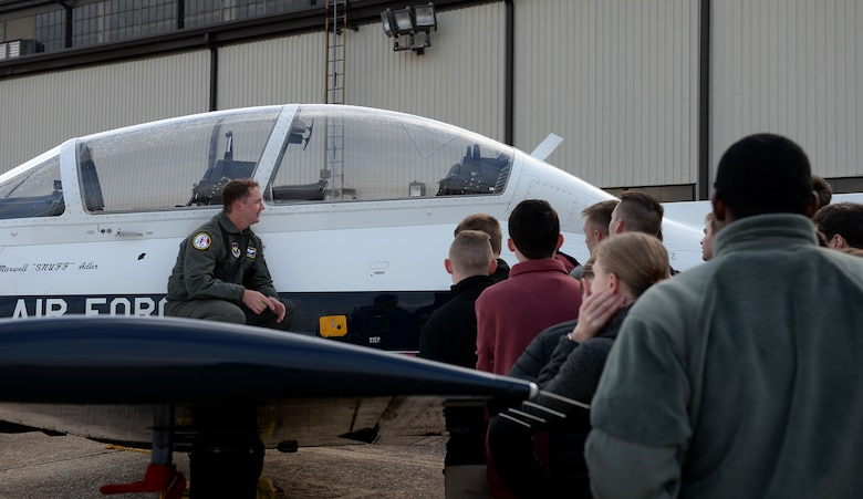 Capt. Aaron Bath, 49th Fighter Training Squadron instructor pilot, shows the T-38C Talon to Mississippi State University Air Force ROTC cadets Nov. 9, 2018, on the flight line at Columbus Air Force Base, Mississippi. Pilots gave brief descriptions of the different aircraft and what they're used for at Columbus AFB. (U.S. Air Force photo by Airman Hannah Bean)