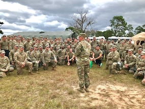 """Army Maj. Gen. William """"Bill"""" Hall, commander, Joint Task Force Civil Support, talks with Soldiers and Airmen of the 503rd Military Police Battalion during their recent field training exercise (FTX) at Camp Blanding, Fla., on Oct. 24, 2018. The 503rd is a subordinate battalion that falls under Task Force Operations, one of the major task forces that make up the Defense Chemical, Biological, Radiological and Nuclear Response Force (DCRF). It is part of a 5,200-personnel team that extends across 30 bases throughout the United States ready for any a crises response. The FTX provided various skilled training in search & rescue and emergency medical treatment. (Courtesy photo by Navy Chief Petty Officer Zach McKinley)"""