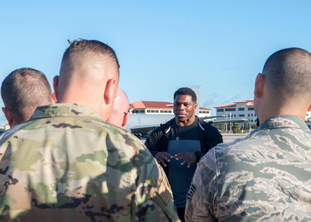 Former NFL running back Herschel Walker speaks to Airmen at MacDill Air Force Base, Fla., Nov. 15, 2018.
