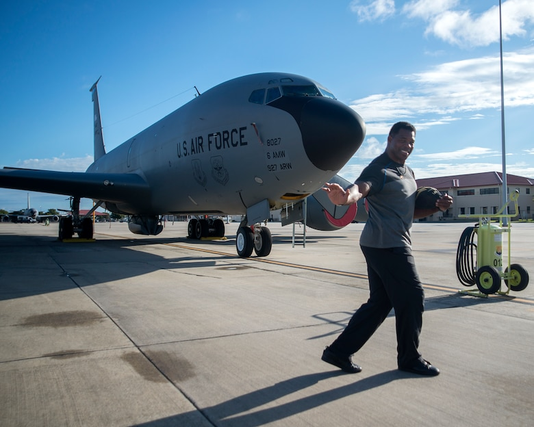 Former NFL running back Herschel Walker pauses for a photo in front of a KC-135 Stratotanker at MacDill Air Force Base, Fla., Nov. 15, 2018.