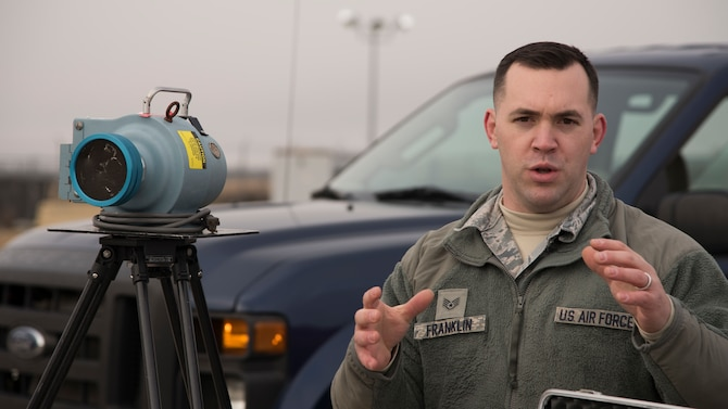 Staff Sgt. Micah Franklin, 92nd Aerospace Medicine Squadron Bio-environmental Engineering craftsman, briefs members of the Spokane Local Emergency Planning Committee on how Team Fairchild hazardous material response teams could deploy a  Radeco high volume air sampler at Fairchild Air Force Base, Washington, Nov. 7, 2018. Emergency response Airmen function much like their civilian counterparts, but are more specialized to handle the specific challenges an air base may face.  (U.S. Air Force Photo/ Senior Airman Ryan Lackey)