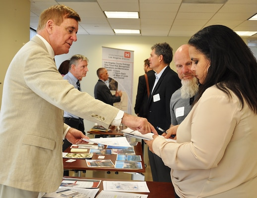 Representatives with the U.S. Army Corps of Engineers Los Angeles District meet with potential business partners during the District's annual Business Opportunities Open House Nov. 13 at the District's Headquarters building in downtown Los Angeles. More than 125 business representatives attended the event, seeking opportunities to do work for the Corps.